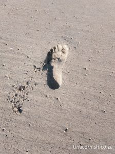 Life Coach Tina Cornish foot print on beach thrive now
